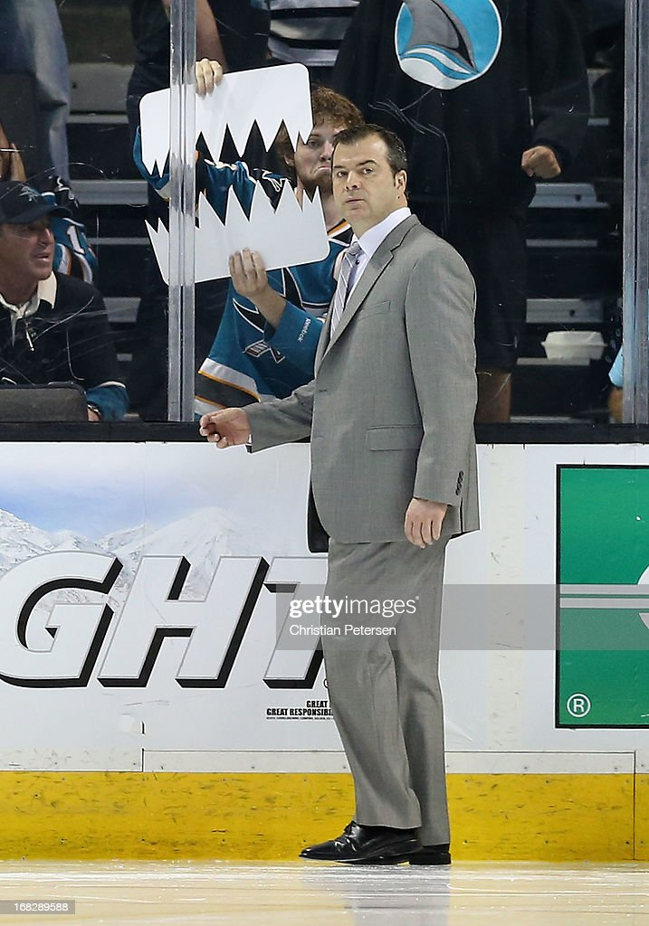 Head coach <a gi-track='captionPersonalityLinkClicked' href=/galleries/search?phrase=Alain+Vigneault&family=editorial&specificpeople=4146583 ng-click='$event.stopPropagation()'>Alain Vigneault</a> of the Vancouver Canucks walks across the ice before the start of the third period in Game Four of the Western Conference Quarterfinals against the San Jose Sharks during the 2013 NHL Stanley Cup Playoffs at HP Pavilion on May 7, 2013 in San Jose, California. The Sharks defeated the Canucks 4-3 to sweep the series 4 games to 0.