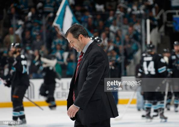 Head Coach Alain Vigneault of the Vancouver Canucks walks off the ice after a loss to the San Jose Sharks in Game One of the Western Conference...