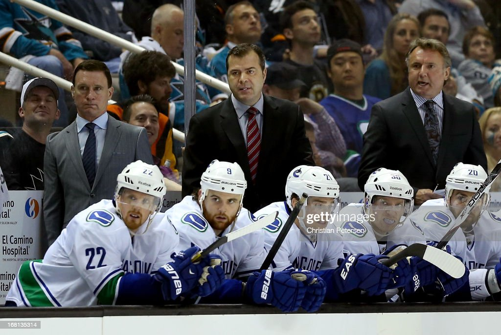 Head coach Alain Vigneault of the Vancouver Canucks watches from the bench in Game Three of the Western Conference Quarterfinals against the San Jose Sharks during the 2013 NHL Stanley Cup Playoffs at HP Pavilion on May 5, 2013 in San Jose, California. The Sharks defeated the Canucks 5-2.