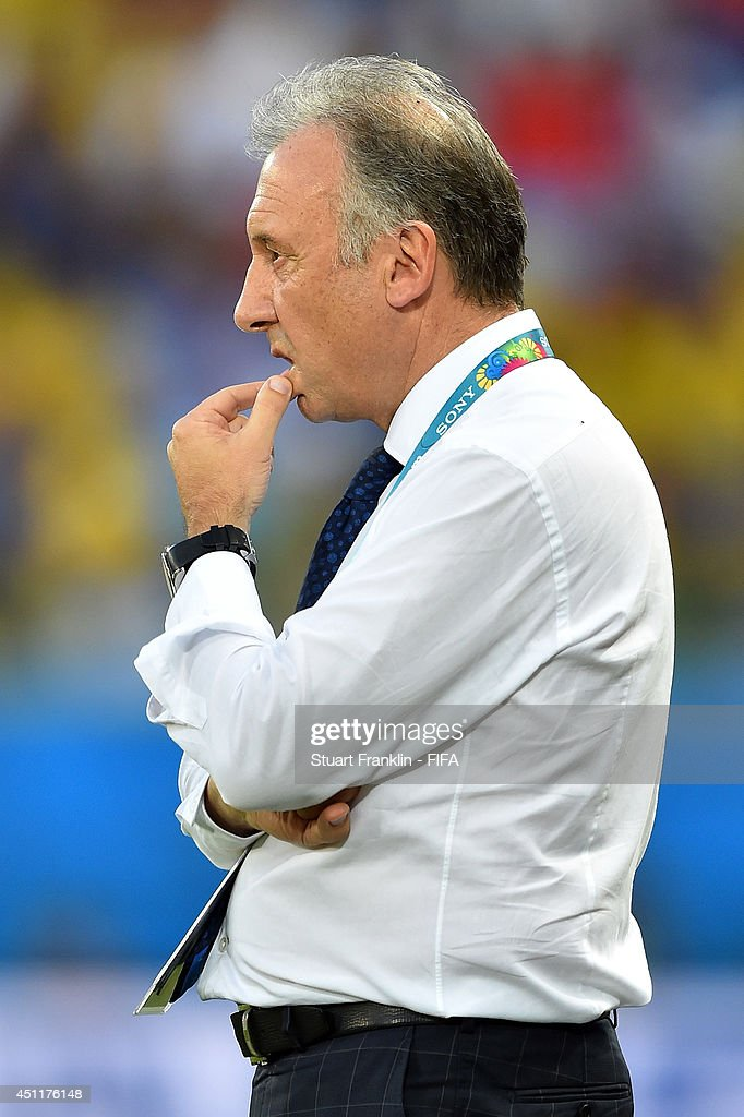 Head coach <a gi-track='captionPersonalityLinkClicked' href=/galleries/search?phrase=Alberto+Zaccheroni&family=editorial&specificpeople=2382697 ng-click='$event.stopPropagation()'>Alberto Zaccheroni</a> of Japan looks on during the 2014 FIFA World Cup Brazil Group C match between Japan and Colombia at Arena Pantanal on June 24, 2014 in Cuiaba, Brazil.