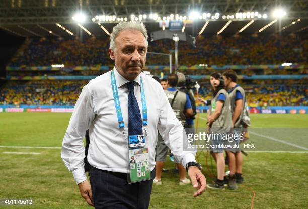 Head coach Alberto Zaccheroni of Japan walks off the pitch after the 14 defeat in the 2014 FIFA World Cup Brazil Group C match between Japan and...