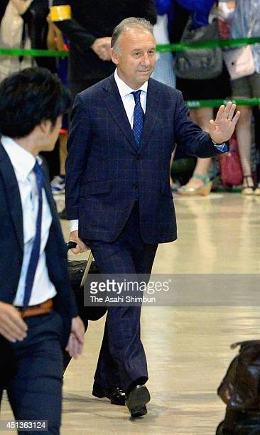 Head coach Alberto Zaccheroni waves to supporters upon arrival at Narita International Airport on June 27 2014 in Narita Chiba Japan