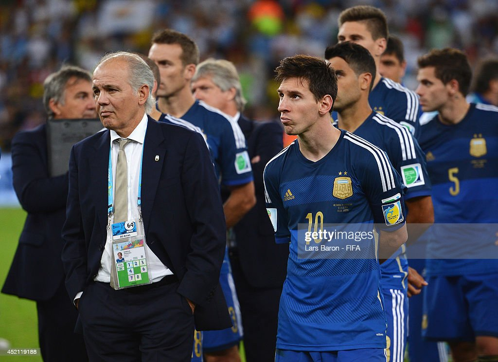 Head coach <a gi-track='captionPersonalityLinkClicked' href=/galleries/search?phrase=Alejandro+Sabella&family=editorial&specificpeople=5768060 ng-click='$event.stopPropagation()'>Alejandro Sabella</a> (L) and <a gi-track='captionPersonalityLinkClicked' href=/galleries/search?phrase=Lionel+Messi&family=editorial&specificpeople=453305 ng-click='$event.stopPropagation()'>Lionel Messi</a> of Argentina show their dejection after the 0-1 defeat in the 2014 FIFA World Cup Brazil Final match between Germany and Argentina at Maracana on July 13, 2014 in Rio de Janeiro, Brazil.