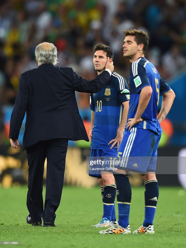 Head coach Alejandro Sabella consoles Lionel Messi of Argentina after geing defeated by Germany 1-0 in extra time during the 2014 FIFA World Cup Brazil Final match between Germany and Argentina at Maracana on July 13, 2014 in Rio de Janeiro, Brazil.
