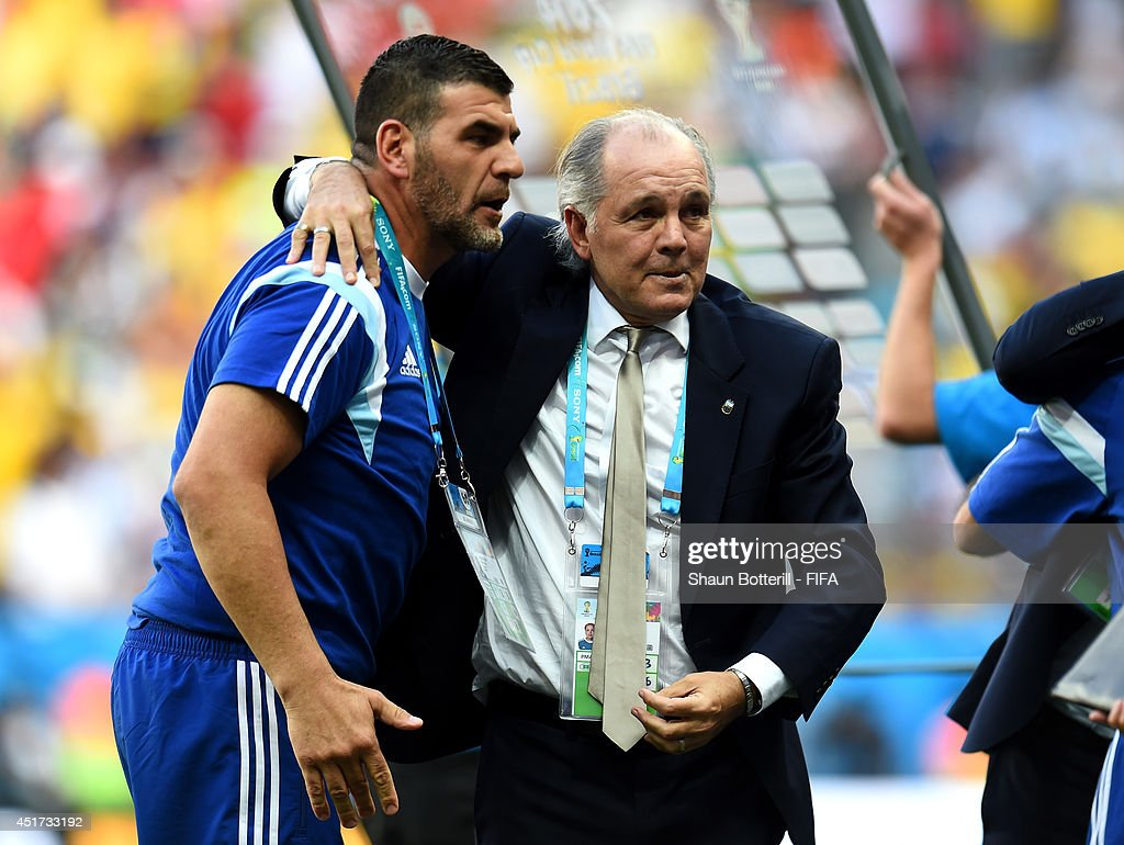 Head coach <a gi-track='captionPersonalityLinkClicked' href=/galleries/search?phrase=Alejandro+Sabella&family=editorial&specificpeople=5768060 ng-click='$event.stopPropagation()'>Alejandro Sabella</a> (R) of Argentina celebrates the 1-0 win after the 2014 FIFA World Cup Brazil Quarter Final match between Argentina and Belgium at Estadio Nacional on July 5, 2014 in Brasilia, Brazil.