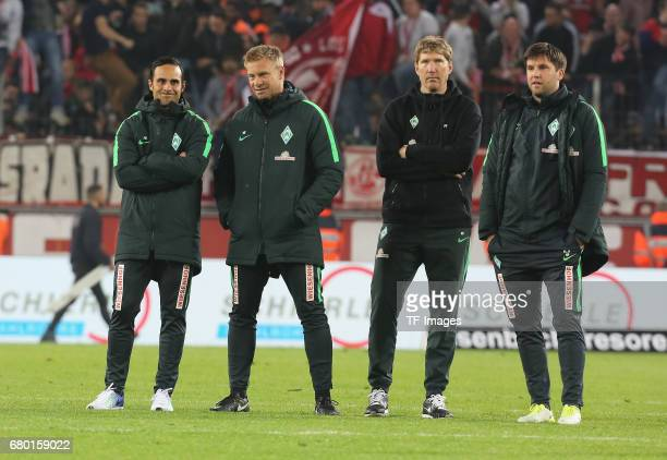 Head coach Alexander Nouri Cocoach Markus Feldhoff Doc Dr Phillip Heitmann and Cocoach Florian Bruns looks on during to the Bundesliga match between...
