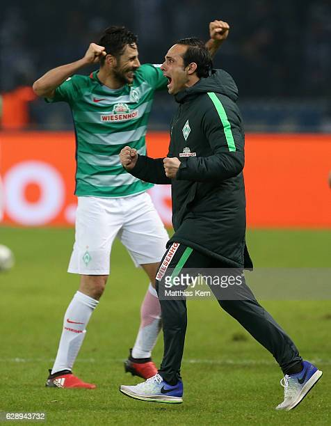 Head coach Alexander Nouri of Bremen and Claudio Pizarro show their delight after winning the Bundesliga match between Hertha BSC and SV Werder...