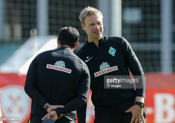 Head coach Alexander Nouri of Bremen and Cocoach Markus Feldhoff of Bremen looks on during the preseason friendly between Werder Bremen and...