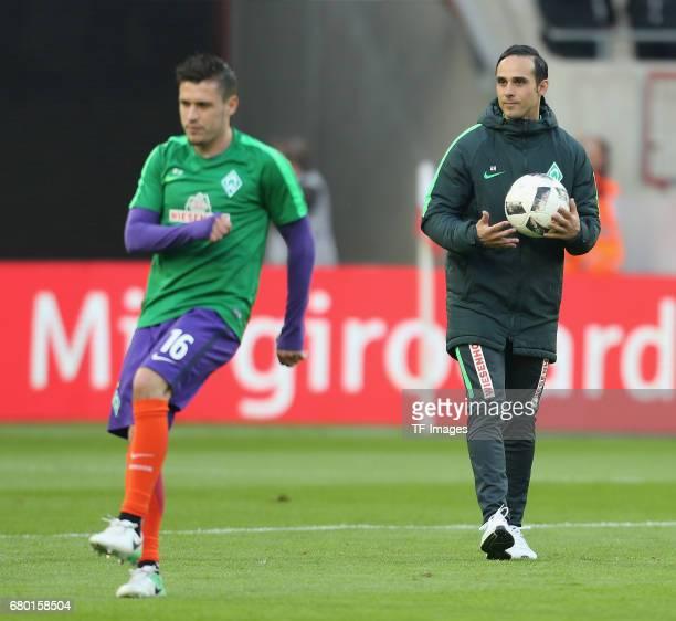 Head coach Alexander Nouri of Bremen and Zlatko Junuzovic looks on during to the Bundesliga match between 1 FC Koeln and Werder Bremen at...