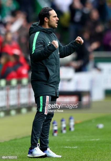 Head coach Alexander Nouri of Bremen celebrates during the Bundesliga match between Werder Bremen and RB Leipzig at Weserstadion on March 18 2017 in...