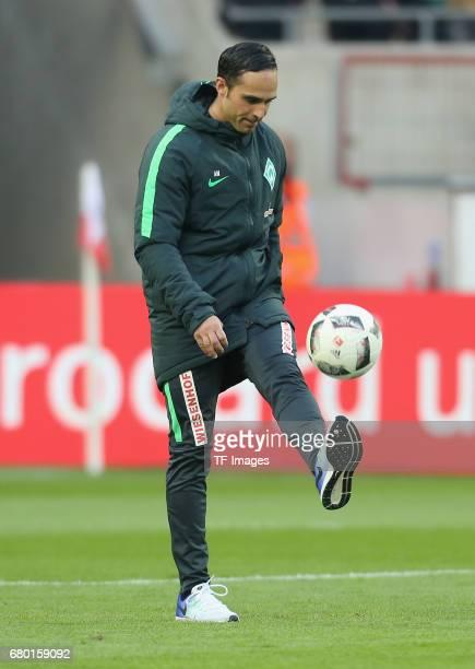 Head coach Alexander Nouri of Bremen controls the ball during to the Bundesliga match between 1 FC Koeln and Werder Bremen at RheinEnergieStadion on...