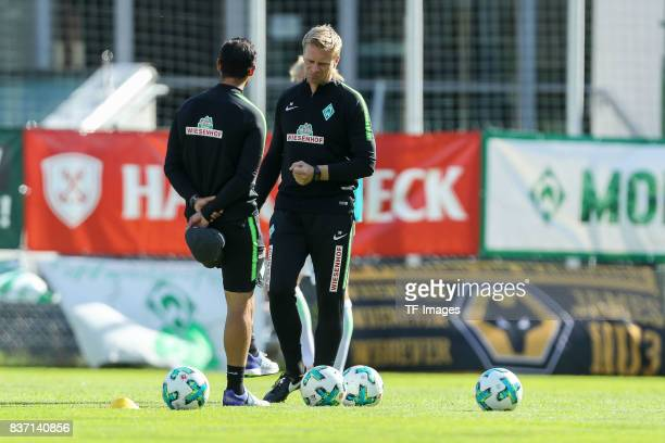 Head coach Alexander Nouri of Bremen speak with Cocoach Markus Feldhoff of Bremen during the preseason friendly between Werder Bremen and...