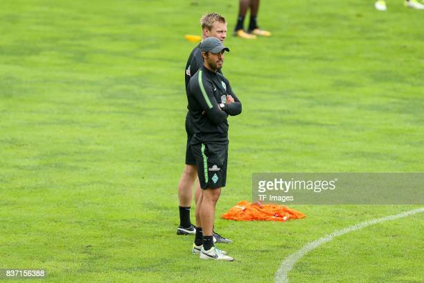 Head coach Alexander Nouri of Werder Bremen and Markus Feldhoff of Werder Bremen looks on during the Training Camp of SV Werder Bremen on July 14...