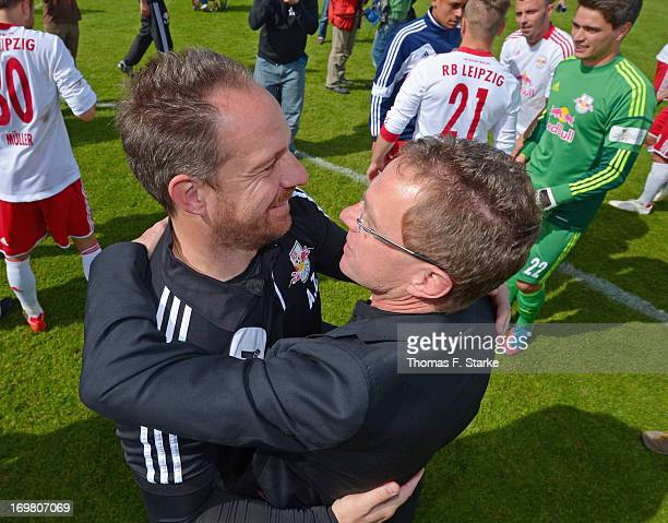 Head coach Alexander Zorniger hugs sports director of RB Leipzig and RB Salzburg Ralf Rangnick after winning the Regionalliga Playoff Second Leg...