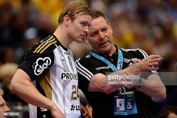 Head coach Alfred Gislason gives instructions to Aron Palmarsson of Kiel during the EHF Final Four match between THW Kiel and HSV Hamburg at Lanxess...