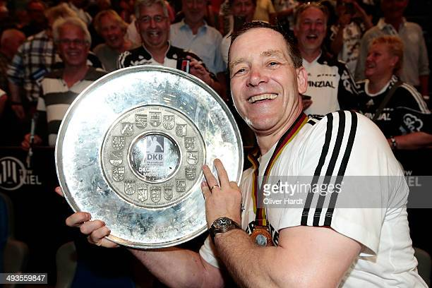 Head coach Alfred Gislason of Kiel celebrate with the trophy after the DKB HBL Bundesliga match between THW Kiel and Fuechse Berlin on May 24 2014 in...
