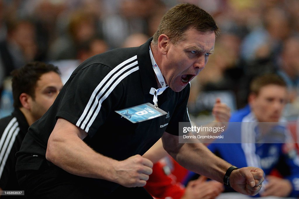Head coach Alfred Gislason of Kiel celebrates during the EHF Final Four final match between THW Kiel and BM Atletico Madrid at Lanxess Arena on May 27, 2012 in Cologne, Germany.