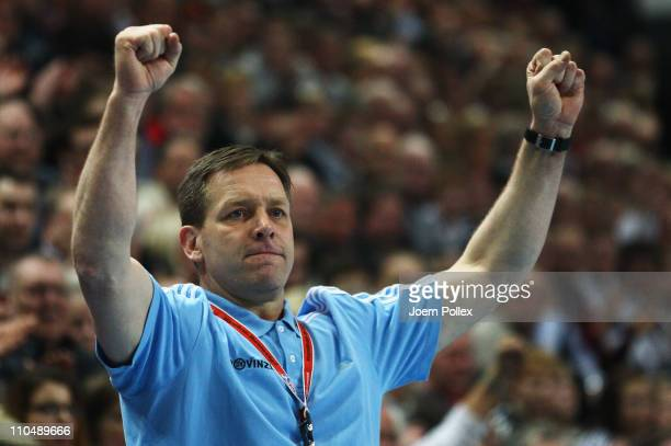 Head coach Alfred Gislason of Kiel celebrates during the Toyota Handball Bundesliga match between THW Kiel and SG FlensburgHandewitt at the...