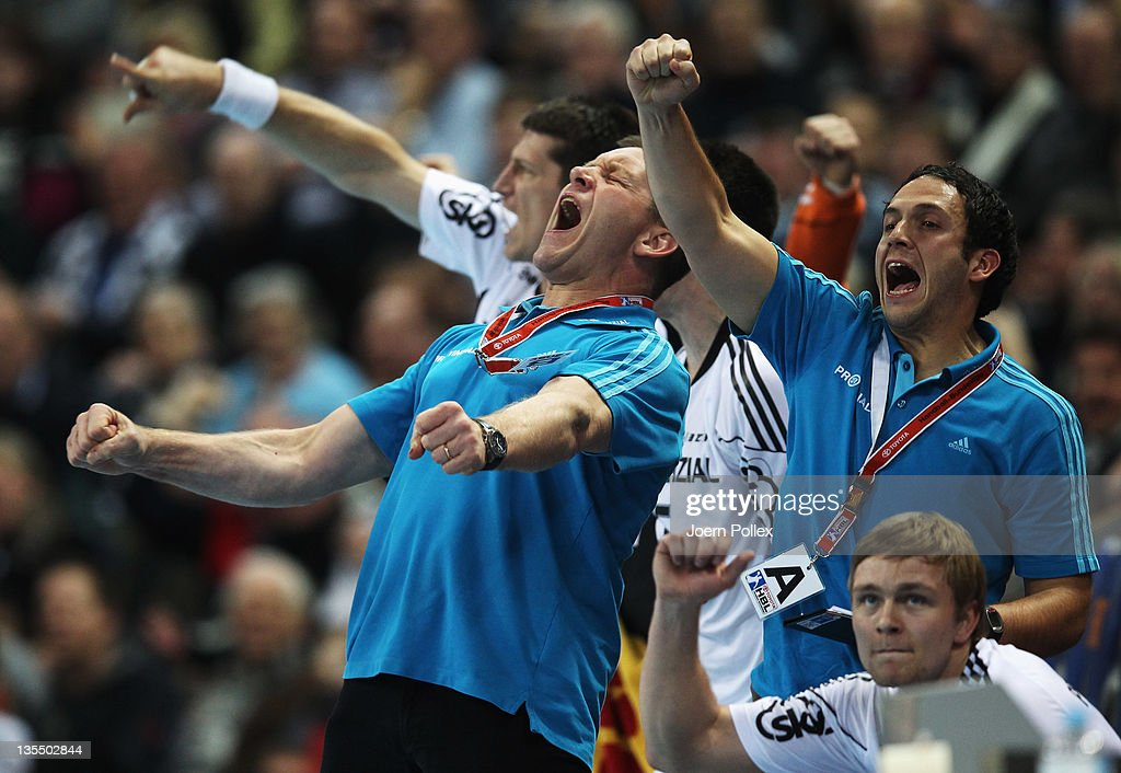 Head coach Alfred Gislason of Kiel celebrates during the Toyota Handball Bundesliga match between THW Kiel and HSV Hamburg at the Sparkassen Arena on December 11, 2011 in Flensburg, Germany.
