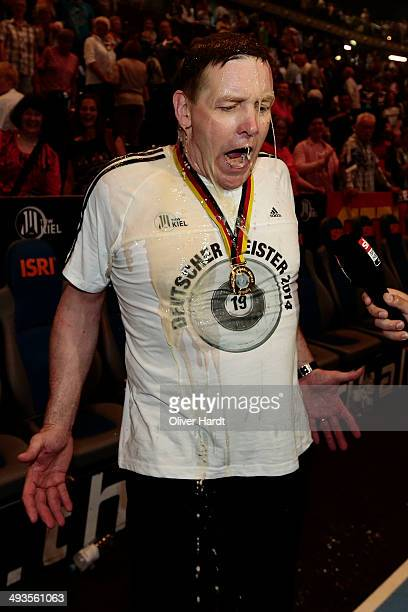 Head coach Alfred Gislason of Kiel has beer poured over him as they celebrate winning the DKB HBL Bundesliga match between THW Kiel and Fuechse...