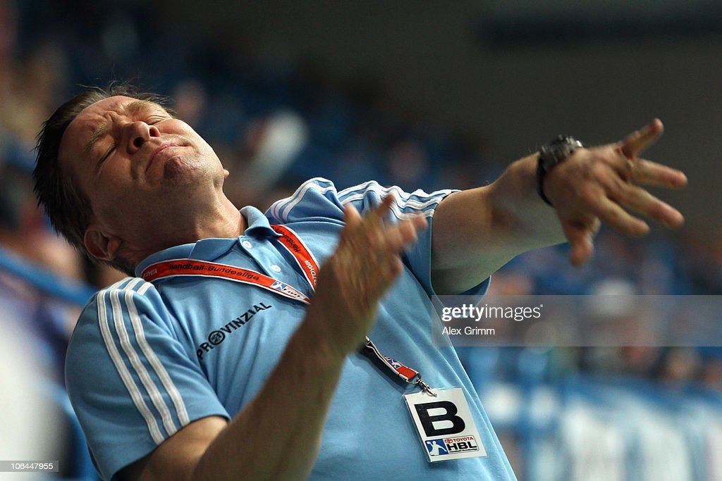 Head coach <a gi-track='captionPersonalityLinkClicked' href=/galleries/search?phrase=Alfred+Gislason&family=editorial&specificpeople=2115165 ng-click='$event.stopPropagation()'>Alfred Gislason</a> of Kiel reacts during the Toyota Handball Bundesliga match between TV Grosswallstadt and THW Kiel at the Frankenstolz Arena on November 2, 2010 in Aschaffenburg, Germany.