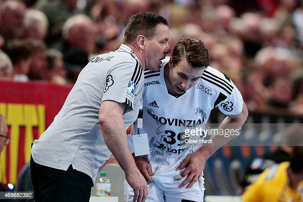 Head coach Alfred Gislason talks with Filip Jicha of Kiel during the DKB HBL Bundesliga match between THW Kiel and Rhein Neckar Loewen at Sparkassen...