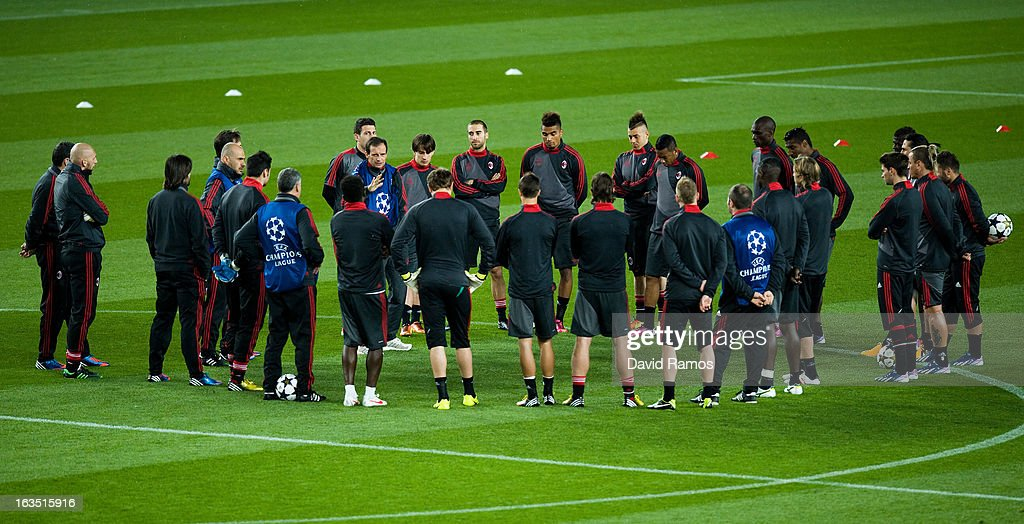 Head coach Allegri Massimiliano of AC Milan speaks to his players during a training session ahead of their UEFA Champions League round of 16 second leg against FC Barcelona at the Camp Nou Stadium on March 11, 2013 in Barcelona, Spain.