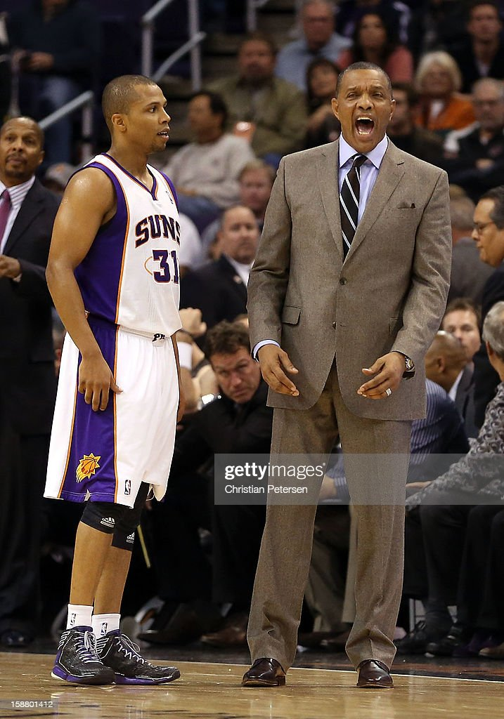 Head coach <a gi-track='captionPersonalityLinkClicked' href=/galleries/search?phrase=Alvin+Gentry&family=editorial&specificpeople=650057 ng-click='$event.stopPropagation()'>Alvin Gentry</a> of the Phoenix Suns reacts alongside <a gi-track='captionPersonalityLinkClicked' href=/galleries/search?phrase=Sebastian+Telfair&family=editorial&specificpeople=202087 ng-click='$event.stopPropagation()'>Sebastian Telfair</a> #31 during the NBA game against the New York Knicks at US Airways Center on December 26, 2012 in Phoenix, Arizona. The Knicks defeated the Suns 99-97.