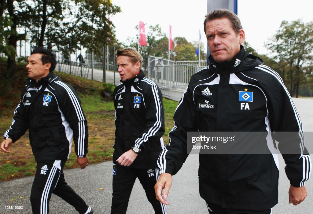 Head coach and sport director Frank Arnesen assistent Rodolfo Cardoso and assistent coach Frank Heinemann of Hamburg are seen prior to a Hamburger SV...