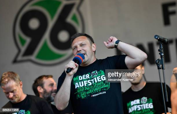 Head coach Andr Breitenreiter of Hannover 96 celebrates together with their supporters the promotion to 1 Bundesliga at Neues Rathaus on May 22 2017...