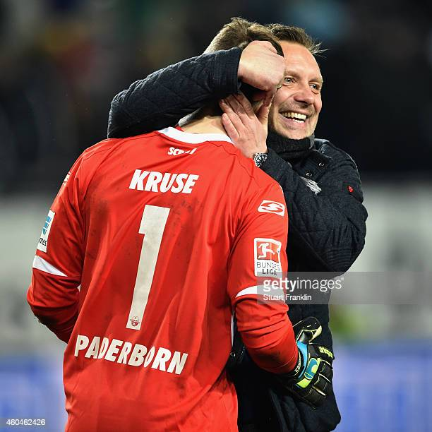 Head coach Andre Breitenreiter of Paderborn hugs goalkeeper Lukas Kruse after the Bundesliga match between VfL Wolfsburg and SC Paderborn 07 at...