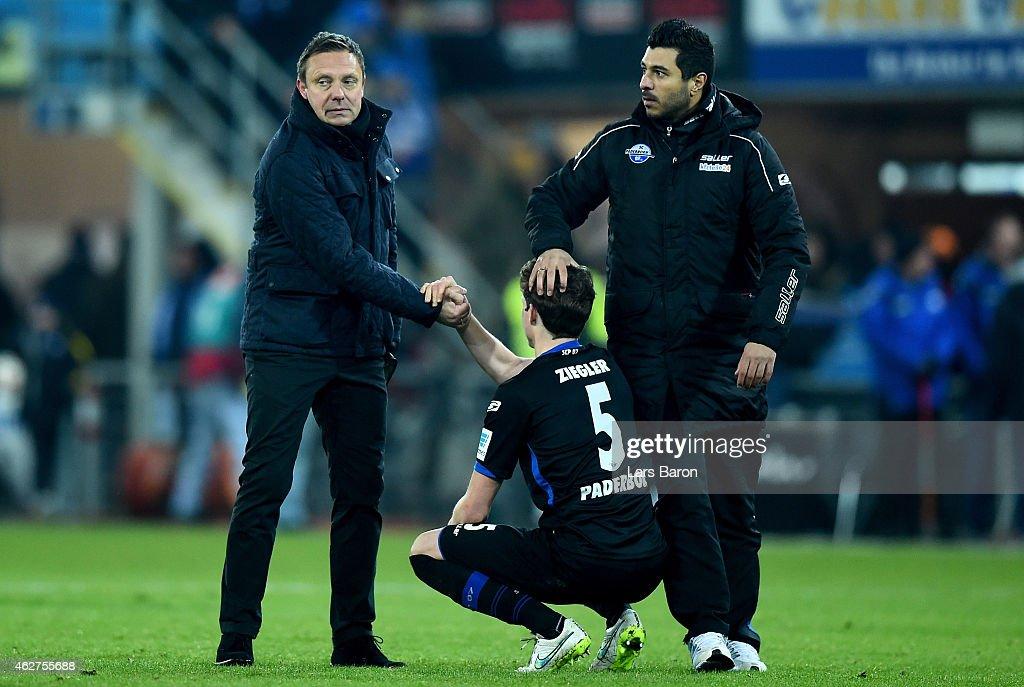 Head coach Andre Breitenreiter of Paderborn looks dejected after loosing the Bundesliga match between SC Paderborn 07 and Hamburger SV at Benteler...