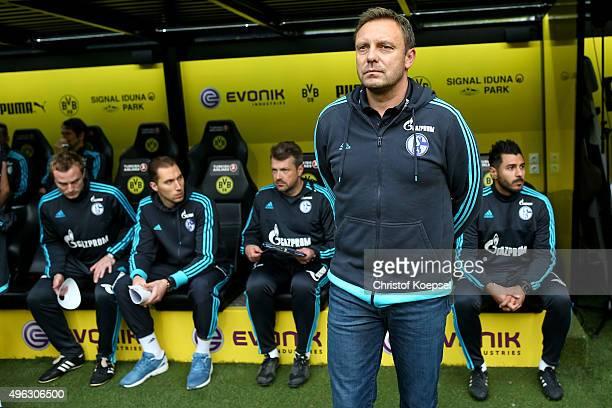 Head coach Andre Breitenreiter of Schalke looks thoughtful prior to the Bundesliga match between Borussia Dortmund and FC Schalke 04 at Signal Iduna...