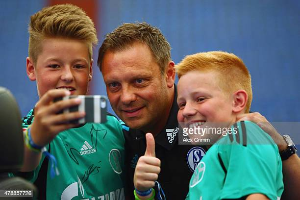 Head coach Andre Breitenreiter poses with fans during the general assembly of FC Schalke 04 at VeltinsArena on June 28 2015 in Gelsenkirchen Germany