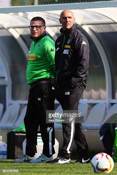Head coach Andre Schubert and manager Max Eberl look on during a Borussia Moenchengladbach training session on day 5 of the Bundesliga Belek training...