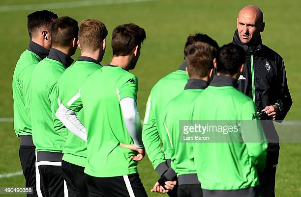 Head coach Andre Schubert gives instructions to his players during a Borussia Moenchengladbach training session on the eve of the UEFA Champions...