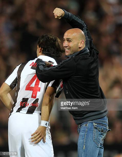 Head coach Andre Schubert of St Pauli jubilates with Fabian Morena after winning the Second Bundesliga match between FC St Pauli and MSV Duisburg at...