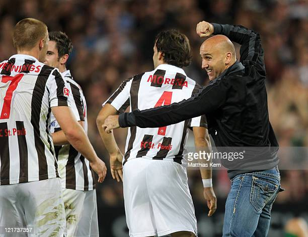 Head coach Andre Schubert of St Pauli jubilates with his players after winning the Second Bundesliga match between FC St Pauli and MSV Duisburg at...