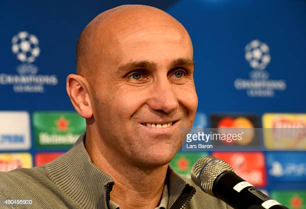 Head coach Andre Schubert smiles during a Borussia Moenchengladbach press conference on the eve of the UEFA Champions League groupe D match against...