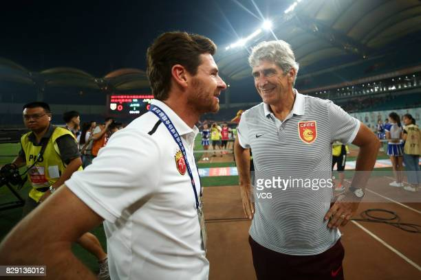 Head coach Andre VillasBoas of Shanghai SIPG talk with manager Manuel Pellegrini of Hebei China Fortune during the 21st round match of 2017 China...