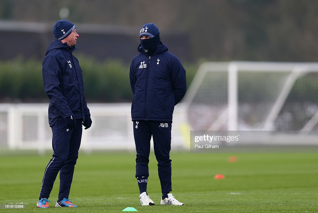 Head Coach Andre Villas-Boas talks to Assistant Head Coach <a gi-track='captionPersonalityLinkClicked' href=/galleries/search?phrase=Steffen+Freund&family=editorial&specificpeople=653880 ng-click='$event.stopPropagation()'>Steffen Freund</a> during a Tottenham Hotspur training session ahead of thier UEFA Cup round of 32 match against Lyon on February 13, 2013 in Enfield, England.