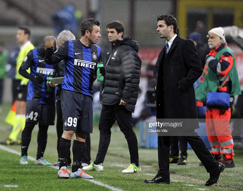 Head coach <a gi-track='captionPersonalityLinkClicked' href=/galleries/search?phrase=Andrea+Stramaccioni&family=editorial&specificpeople=9070912 ng-click='$event.stopPropagation()'>Andrea Stramaccioni</a> and <a gi-track='captionPersonalityLinkClicked' href=/galleries/search?phrase=Antonio+Cassano&family=editorial&specificpeople=214558 ng-click='$event.stopPropagation()'>Antonio Cassano</a> (L) of FC Inter Milan talk during the TIM cup match between FC Internazionale Milano and Bologna FC at Stadio Giuseppe Meazza on January 15, 2013 in Milan, Italy.