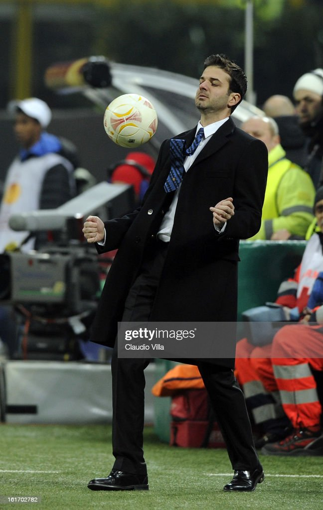 Head coach <a gi-track='captionPersonalityLinkClicked' href=/galleries/search?phrase=Andrea+Stramaccioni&family=editorial&specificpeople=9070912 ng-click='$event.stopPropagation()'>Andrea Stramaccioni</a> of FC Inter Milan controls a ball during the UEFA Europa League round of 32 first leg match between FC Internazionale Milano and CFR 1907 Cluj at San Siro Stadium on February 14, 2013 in Milan, Italy.