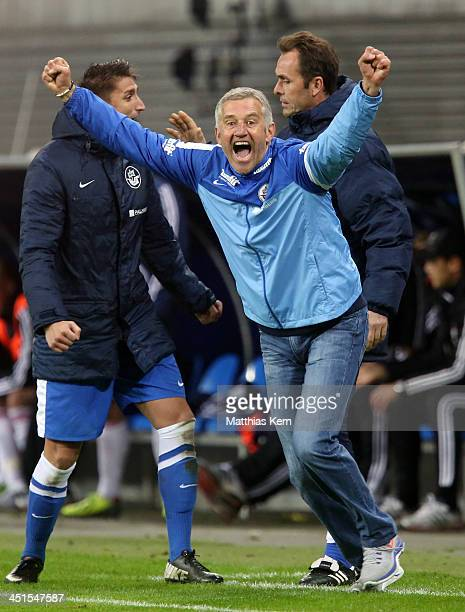 Head coach Andreas Bergmann of Rostock jubilates after winning the third league match between RB Leipzig and FC Hansa Rostock at Redbull Arena on...
