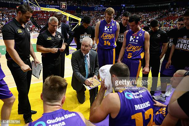 Head coach Andrew Gaze talks to the players during a time out during the round four NBL match between the Sydney Kings and the Brisbane Bullets at...