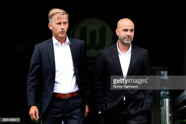 Head coach Andries Jonker of Wolfsburg and head coach Peter Bosz of Dortmund enter the pitch prior to the Bundesliga match between VfL Wolfsburg and...