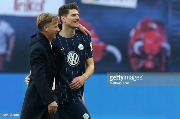 Head coach Andries Jonker of Wolfsburg and Mario Gomez show their delight after winning the Bundesliga match between RB Leipzig and VfL Wolfsburg at...