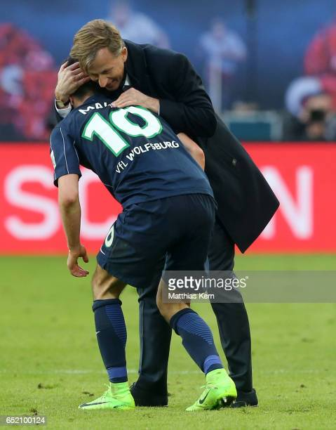 Head coach Andries Jonker of Wolfsburg and Yunus Malli show their delight after winning the Bundesliga match between RB Leipzig and VfL Wolfsburg at...