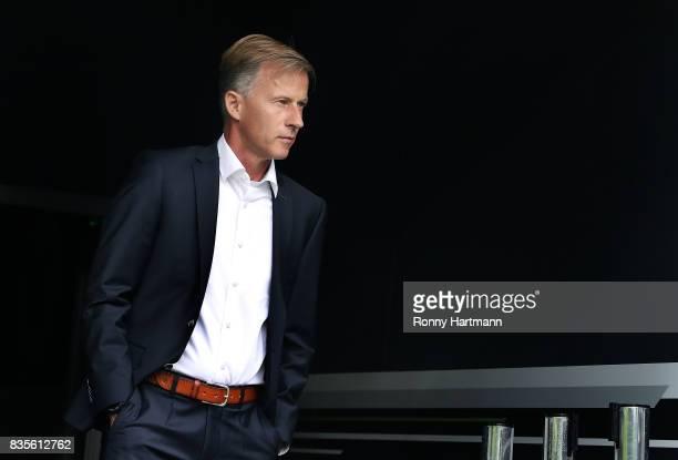 Head coach Andries Jonker of Wolfsburg enters the pitch prior to the Bundesliga match between VfL Wolfsburg and Borussia Dortmund at Volkswagen Arena...