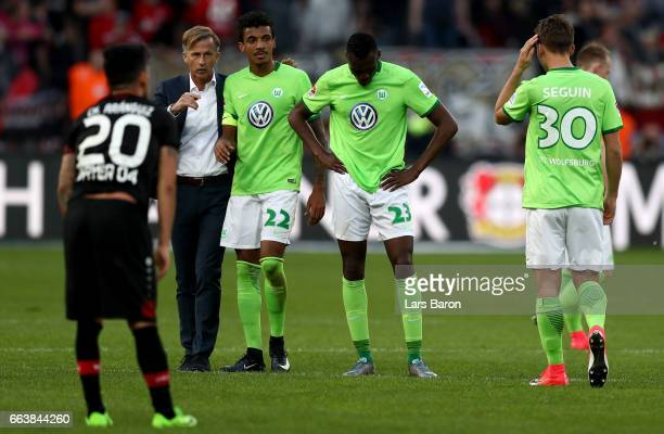 Head coach Andries Jonker of Wolfsburg is seen with Luis Gustavo of Wolfsburg after the Bundesliga match between Bayer 04 Leverkusen and VfL...